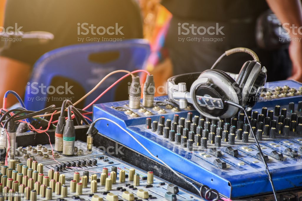 Sound mixer control panel with headphone in outdoor concert event. stock photo