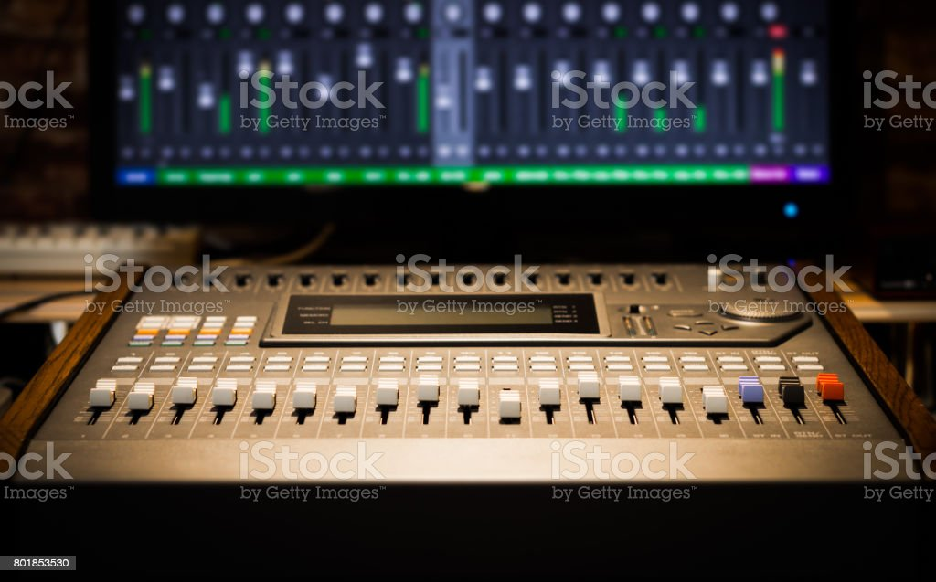 sound mixer fader, signal level on screen. music technology background stock photo