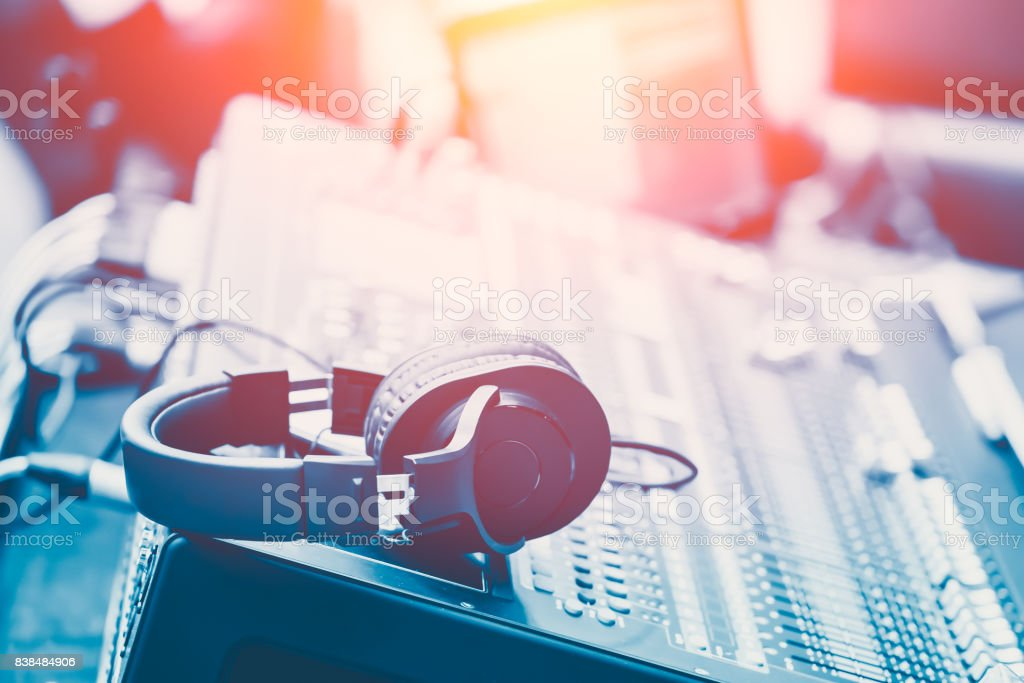 Sound Mixer with headphone musical mixing engineer concept background blue vintage color tone stock photo