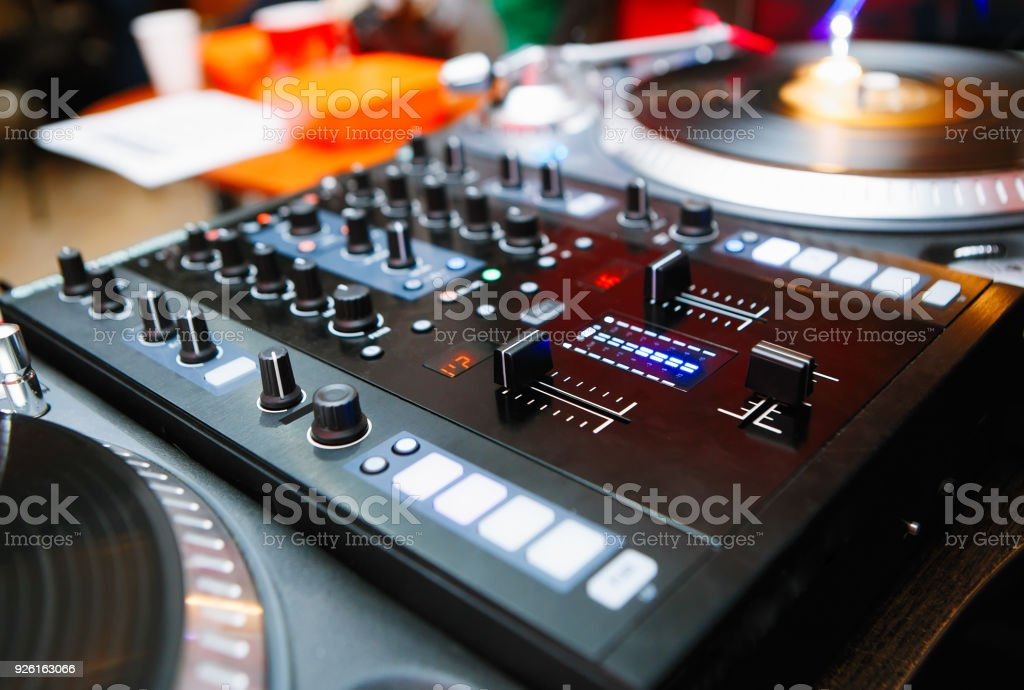 Sound mixing controller for disc jockey on stage in the club stock photo