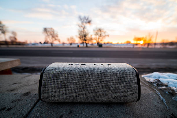 Sound of the Streets Bluetooth Speaker on the street at Sunrise bluetooth stock pictures, royalty-free photos & images