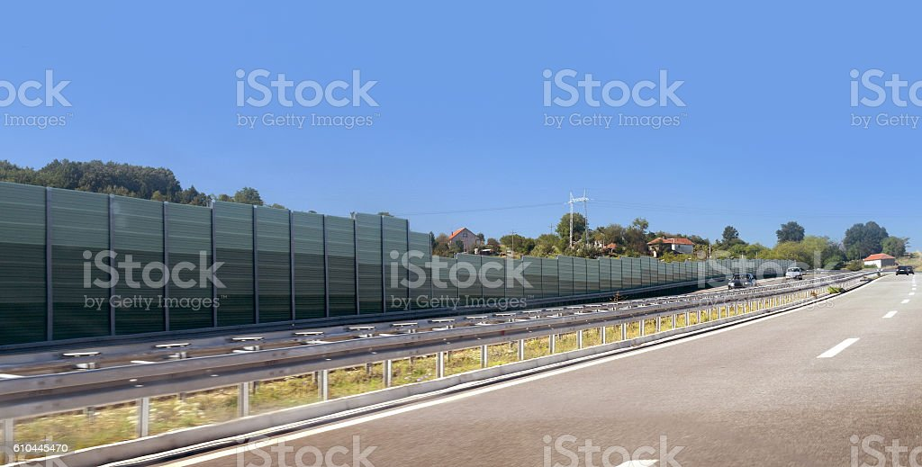 Sound protection fence by the highway stock photo