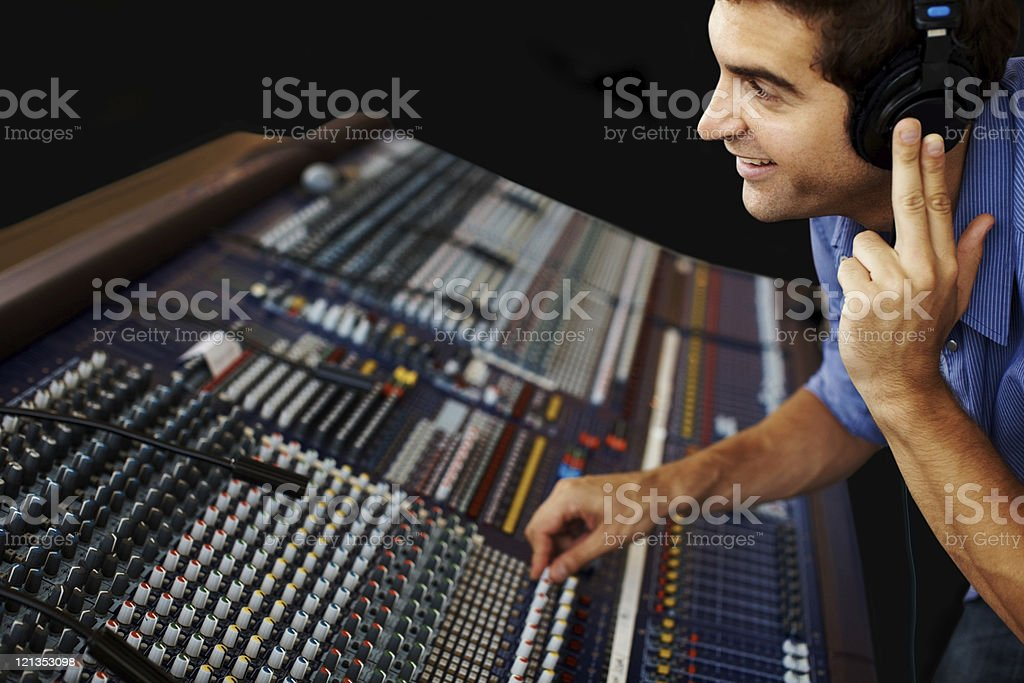 Sound recording studio  - Young guy working on mixer royalty-free stock photo