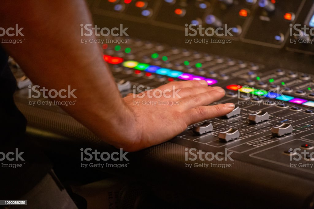 Sound Tech on Musical Sound Board Audio Equipment - Royalty-free Audio Equipment Stock Photo