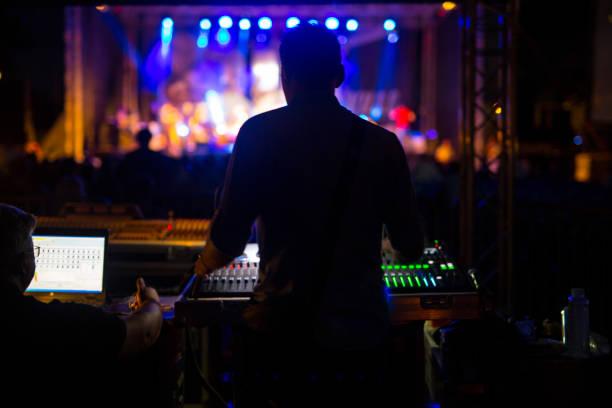 Sound technician at music festival stock photo