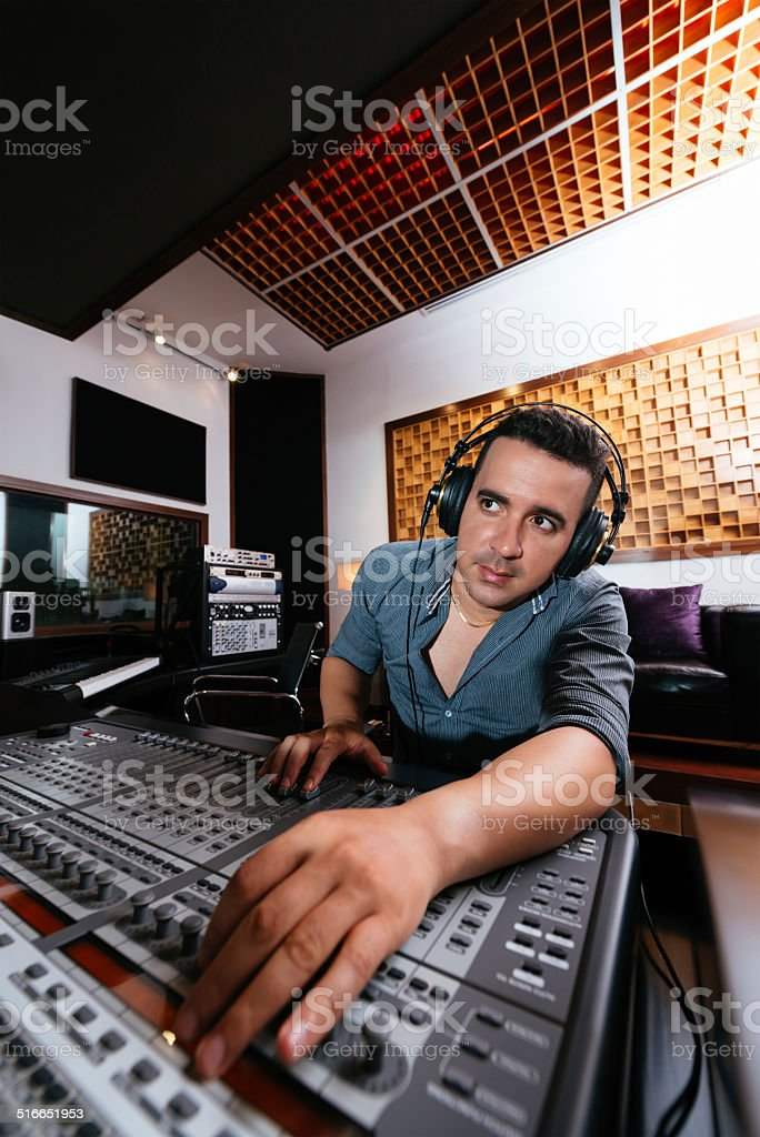 Sound technician in recording studio stock photo
