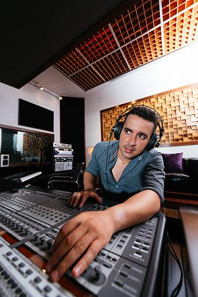 Sound technician in recording studio stock photo