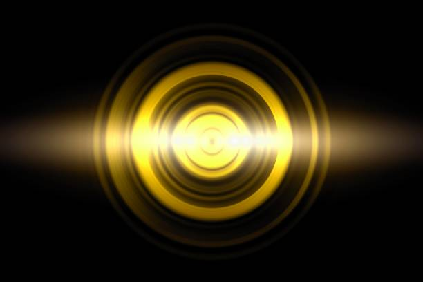 Sound waves oscillating golden light with circle spin, abstract background stock photo