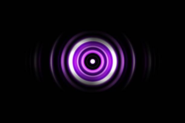 Sound waves oscillating purple light with circle spin abstract background stock photo