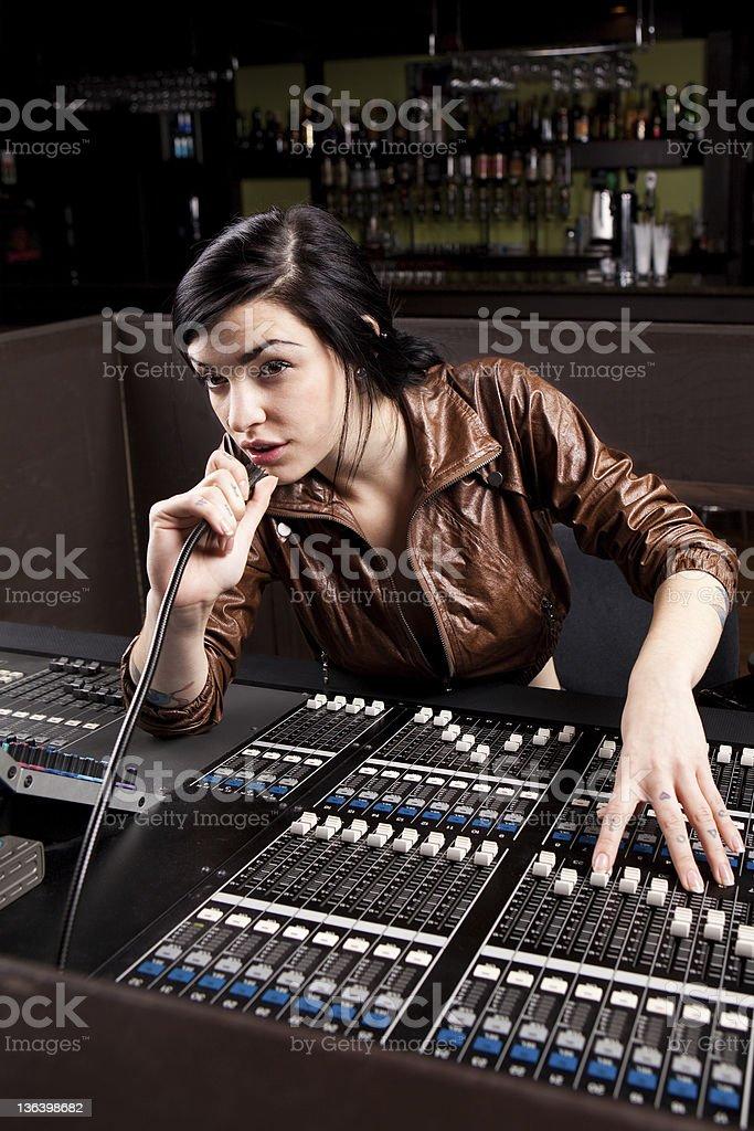 A soundboard technician performing a sound check stock photo