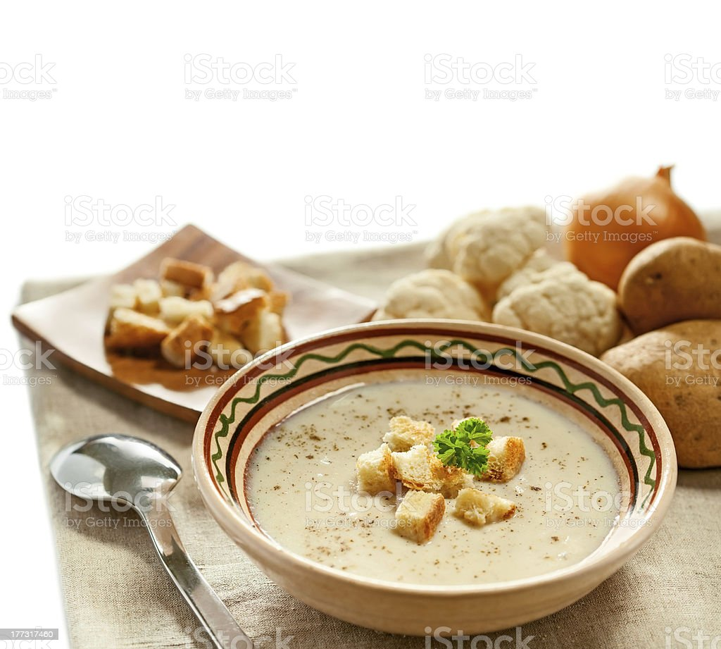 Soup and ingredients on the tablecloth royalty-free stock photo