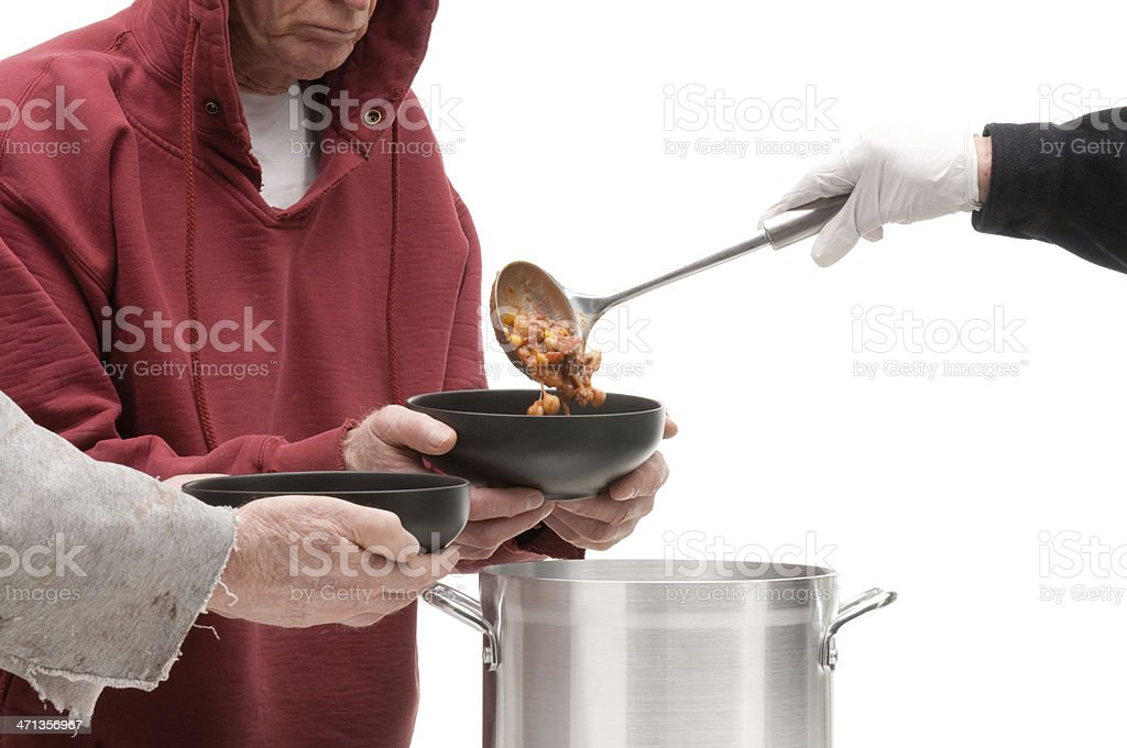 Soup being ladled into bowl of homeless man-isolated on white stock photo