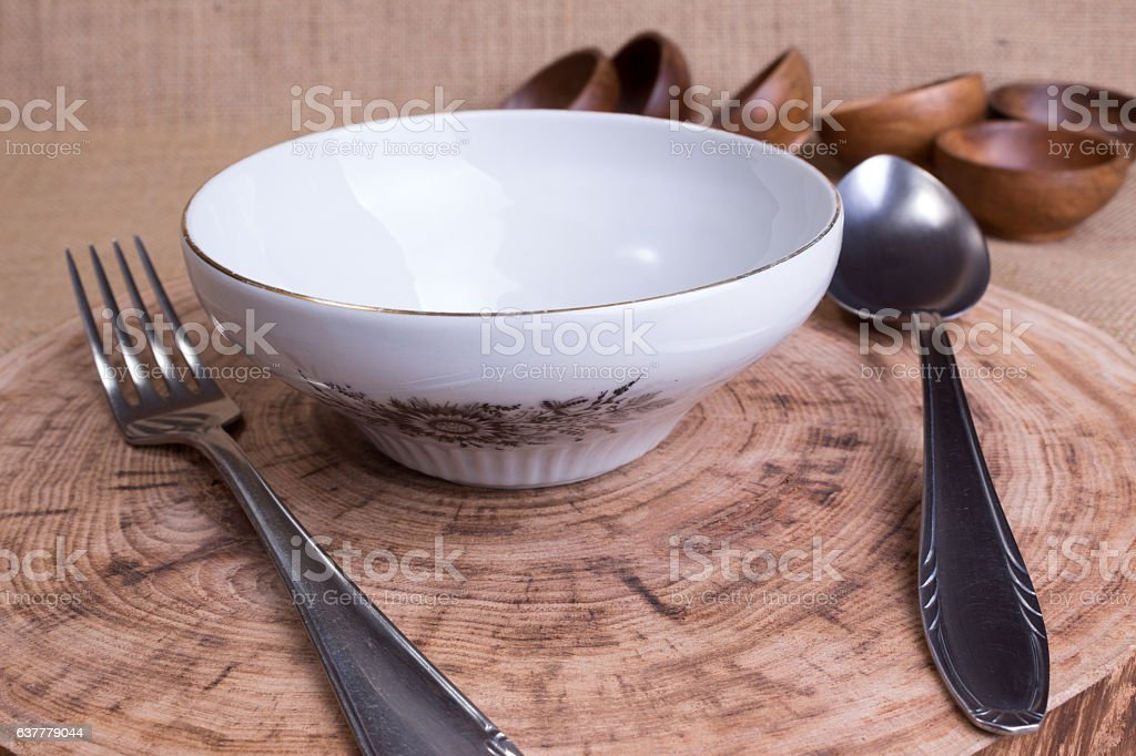 Soup bowl,fork and spoon on wooden table stock photo