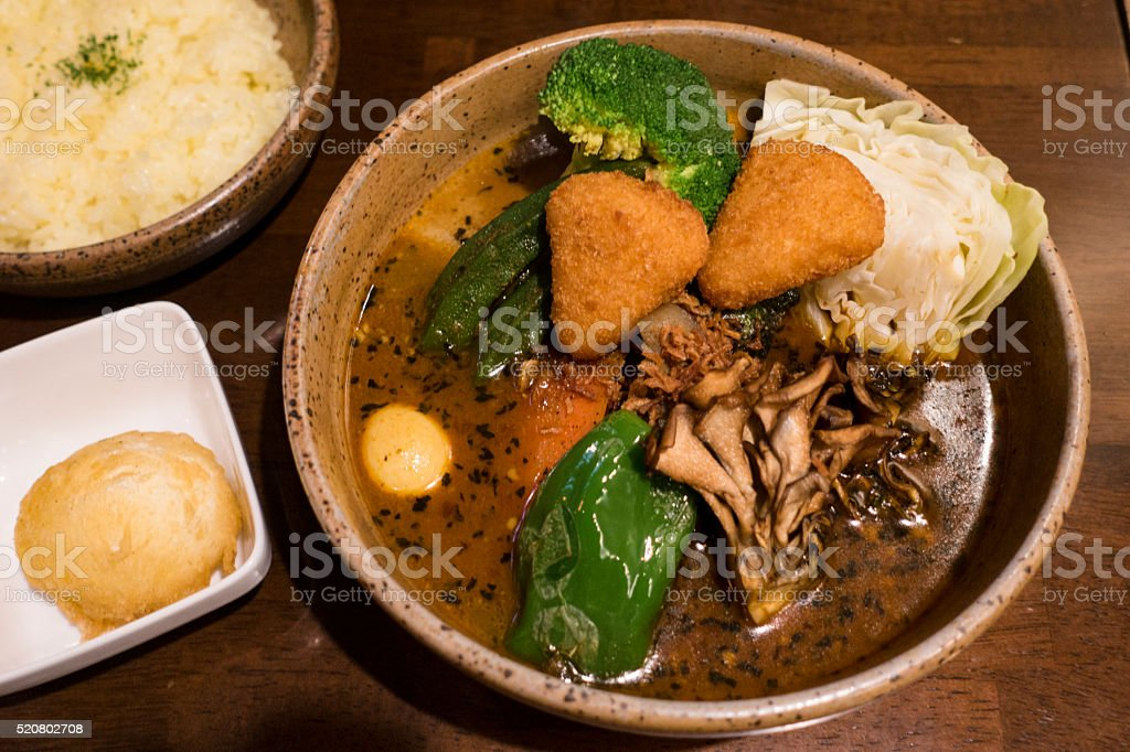 Soup Curry Chicken and Vegetables Bowl in Sapporo, Hokkaido, Japan stock photo