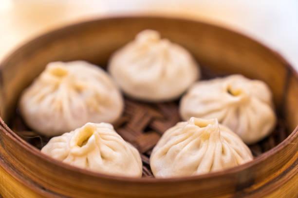 soup dumplings - dumplings stock photos and pictures