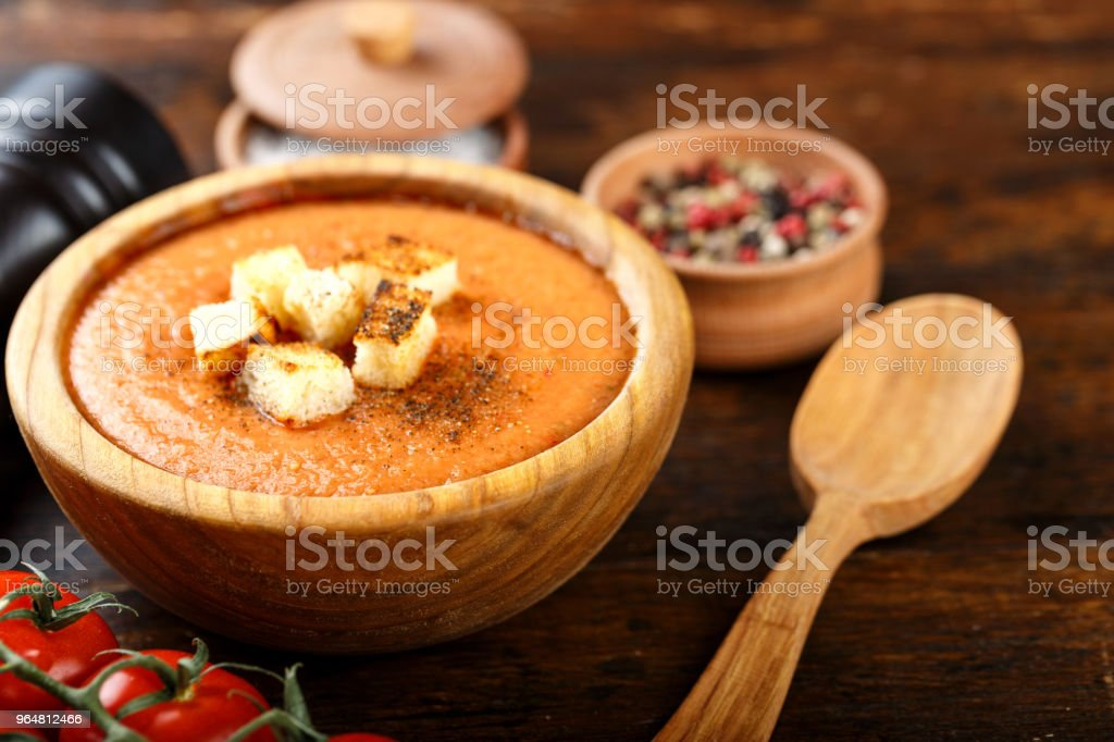 soup gazpacho on a wooden background in a wooden plate. royalty-free stock photo