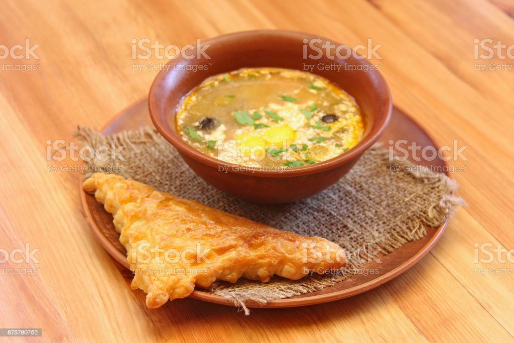 Soup in a clay plate. Rustic food. stock photo