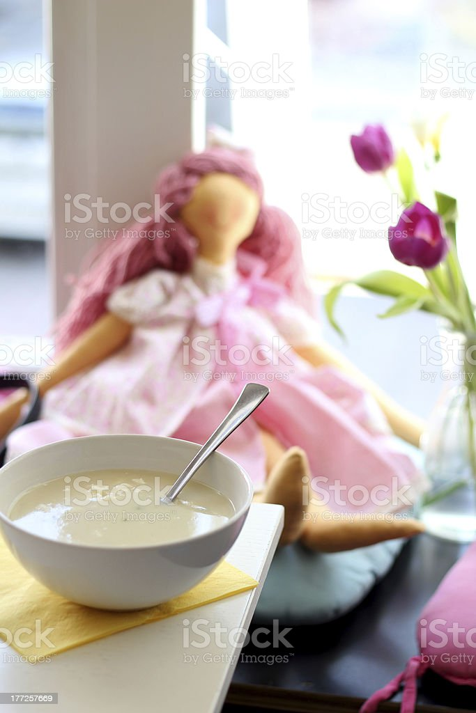 Soup in a restaurant with pink rag doll stock photo