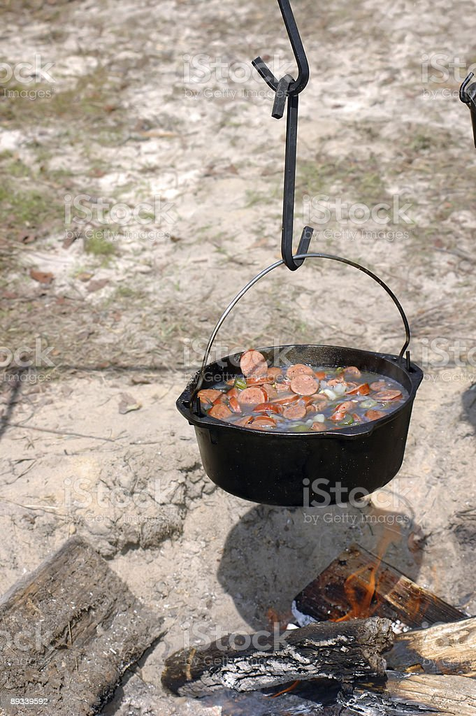 Soup simmering over an open fire stock photo