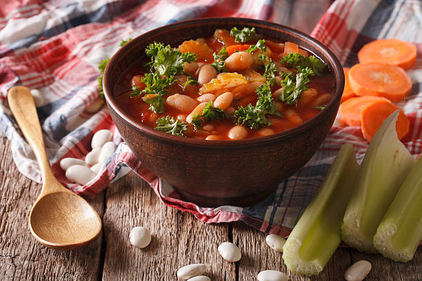 soup with beans, carrots and celery close-up. horizontal - minestrone foto e immagini stock