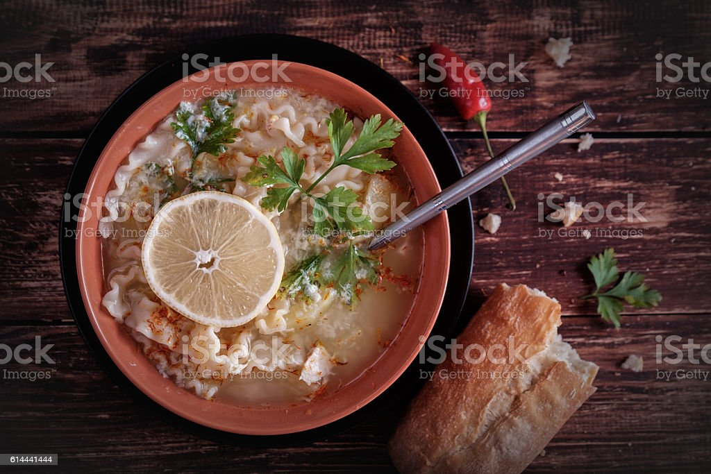 Soup with bread on rustic background stock photo