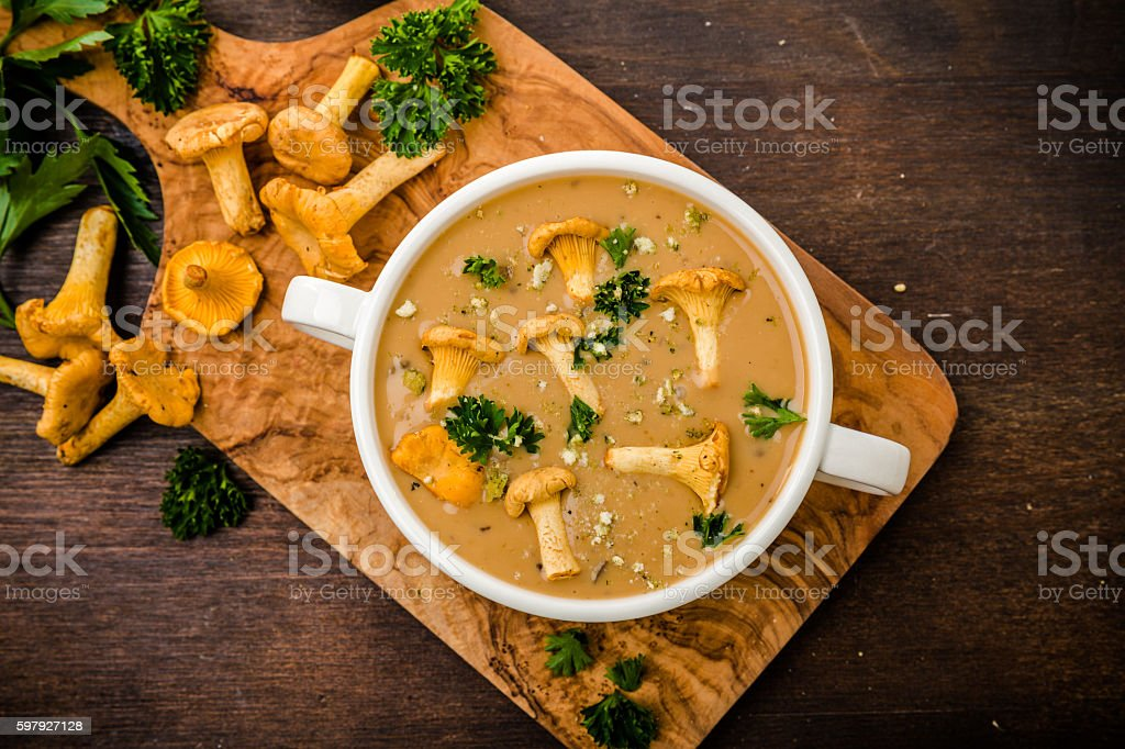 Soup with chanterelles and parsley stock photo