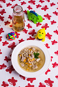 Soup with pearl barley and meat for baby food. Selective focus.