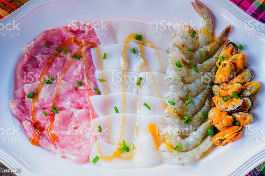 Soup with pork pot shrimp squid shellfish Seafood Hot Pot thai style royalty-free stock photo