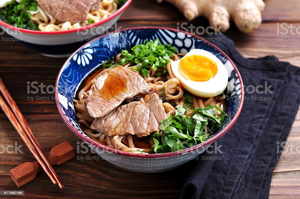 Soup with soba and ramen noodles, beef, ginger, green onions – Foto