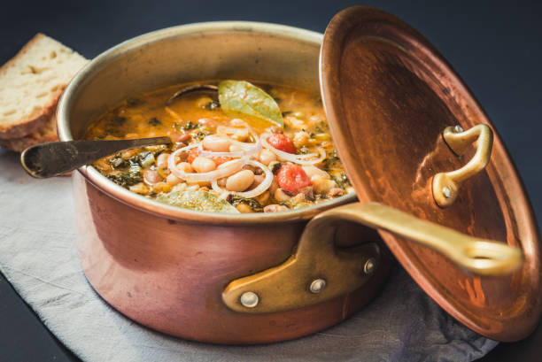 soup with vegetables, cannellini beans, kale.typical tuscan soup. - minestrone foto e immagini stock