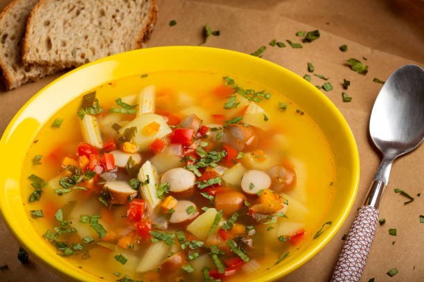 Soup with vegetables, sausages and pasta stock photo