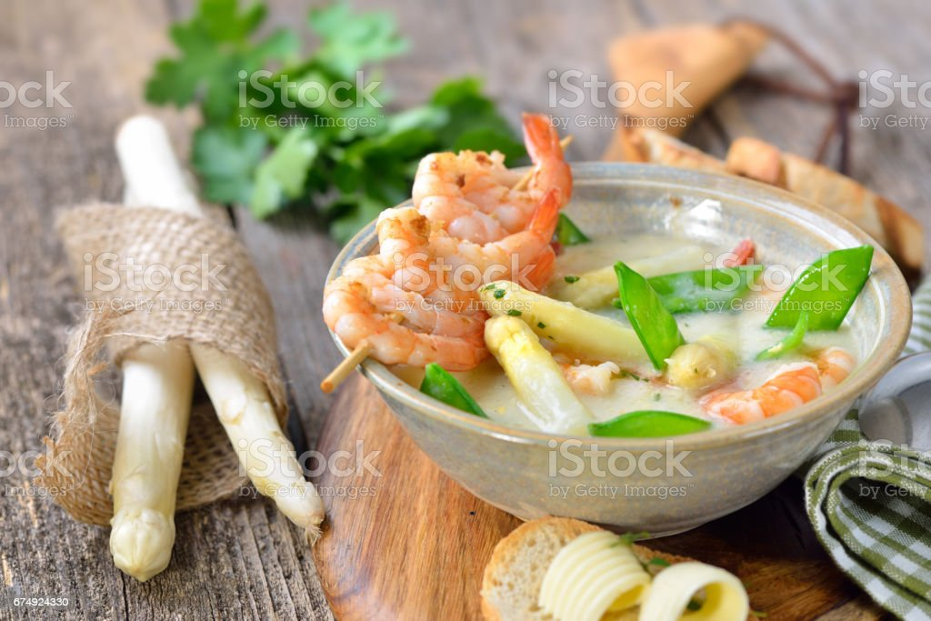 Soup with white asparagus and prawns royalty-free stock photo