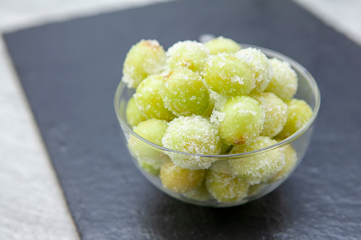 Fashionable new recipe of frozen grapes coated in lime juice and rolled in sugar