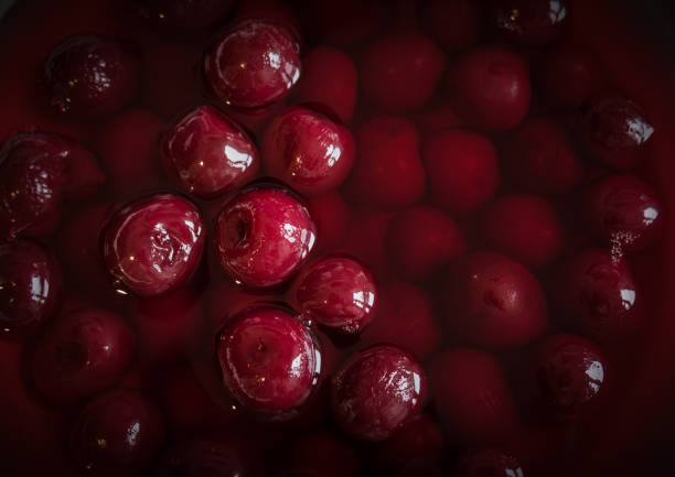 Sour cherries in syrup. Top view. stock photo