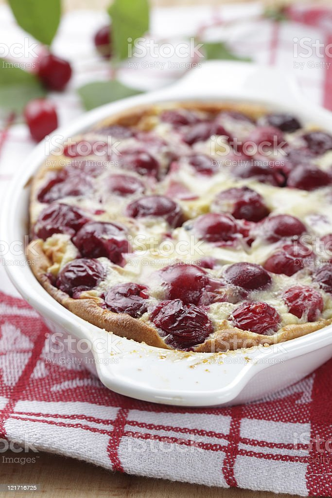 Sour cherry clafoutis in casserole dish fresh out of oven stock photo