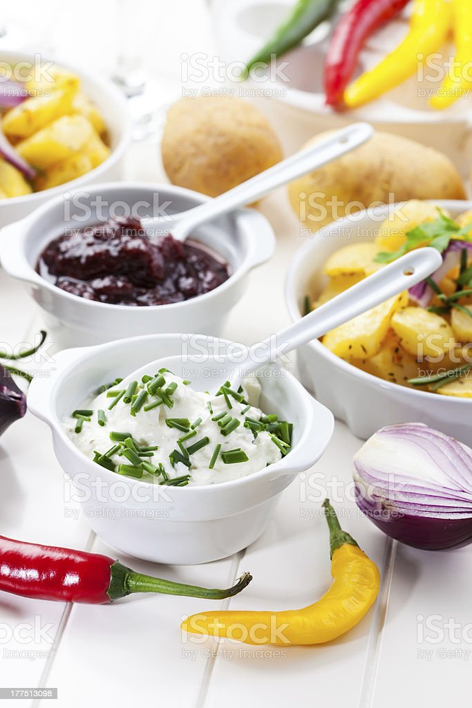 Sour cream and chutney with baked potatoes stock photo