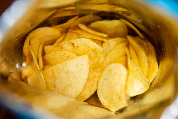 Sour cream and onion flavored potato chips in bag stock photo