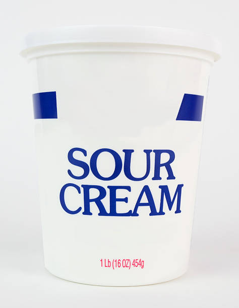 Sour Cream Container of sour cream. Vertical. sour cream stock pictures, royalty-free photos & images
