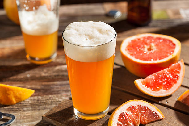 sour grapefruit craft beer - grapefruit cocktail stock photos and pictures
