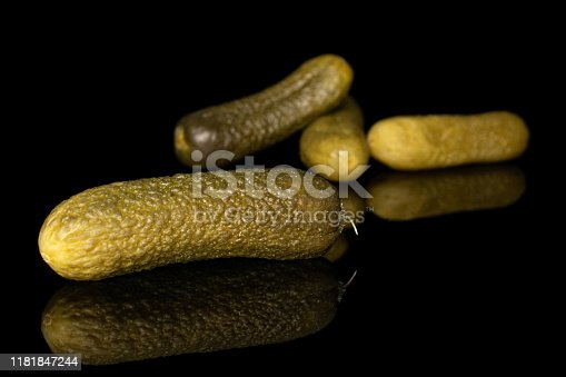 istock Sour green pickles isolated on black glass 1181847244