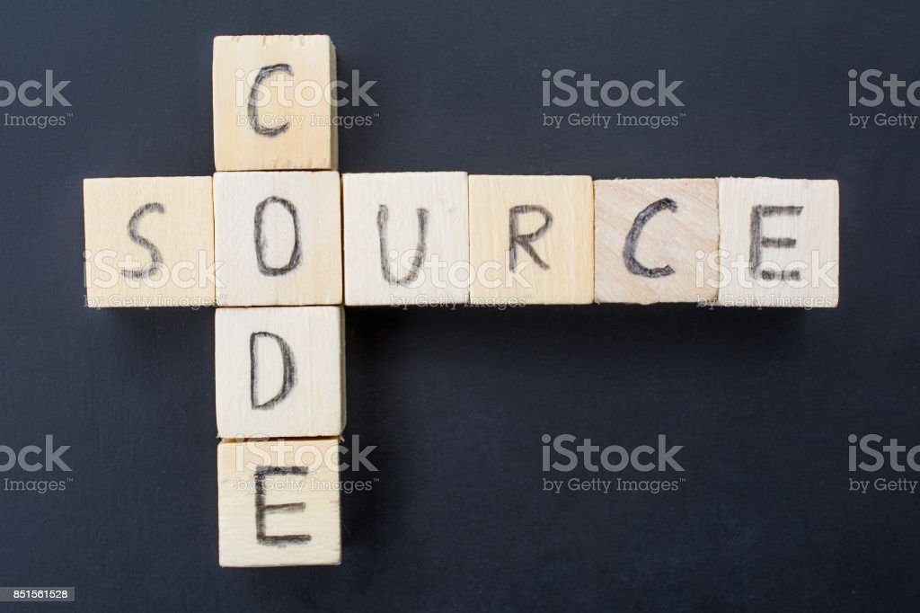 Source Code concept close-up on a blackboard stock photo