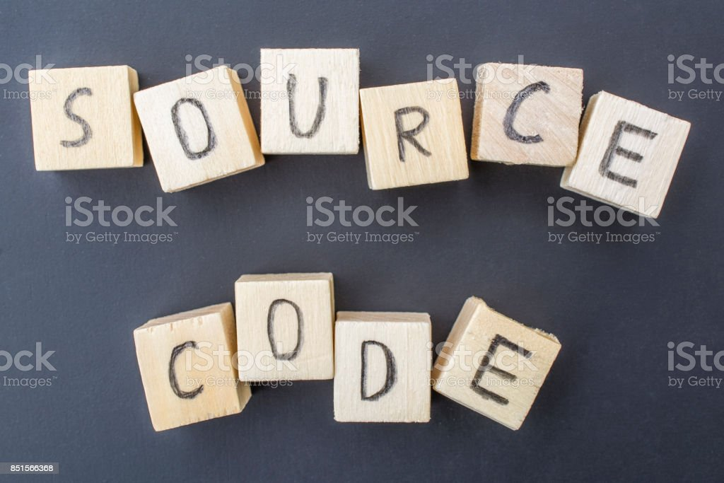 Source Code concept close-up on blackboard background stock photo