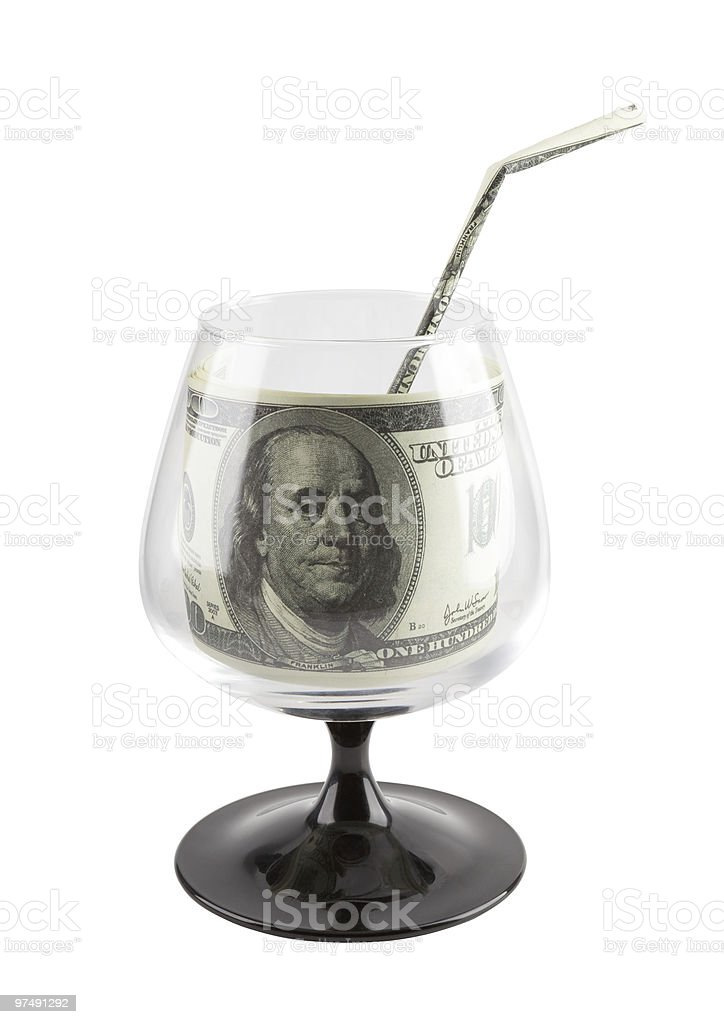 Source of finance. Money drink in footed glass. royalty-free stock photo