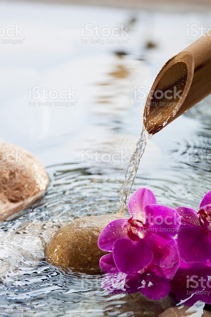 source of soothing water and femininity stock photo