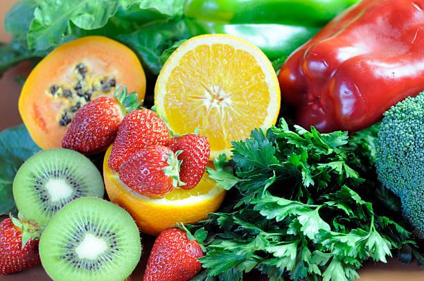 sources of vitamin c close up. - vitamine c stockfoto's en -beelden