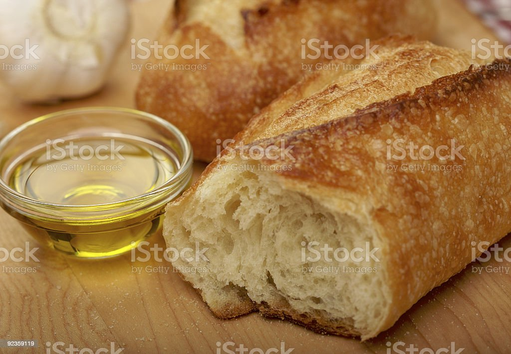 Sourdough Bread, Olive Oil and Garlic Cloves royalty-free stock photo