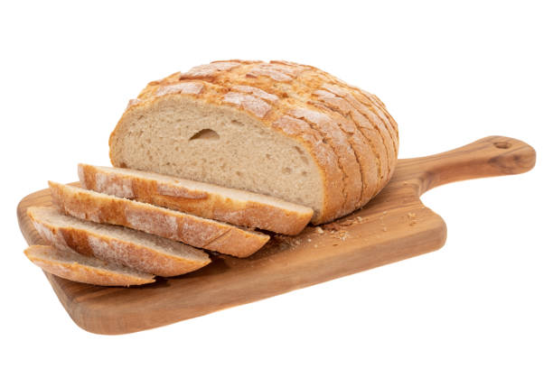 Sourdough bread Sliced sourdough bread on a cutting board - white background round loaf stock pictures, royalty-free photos & images