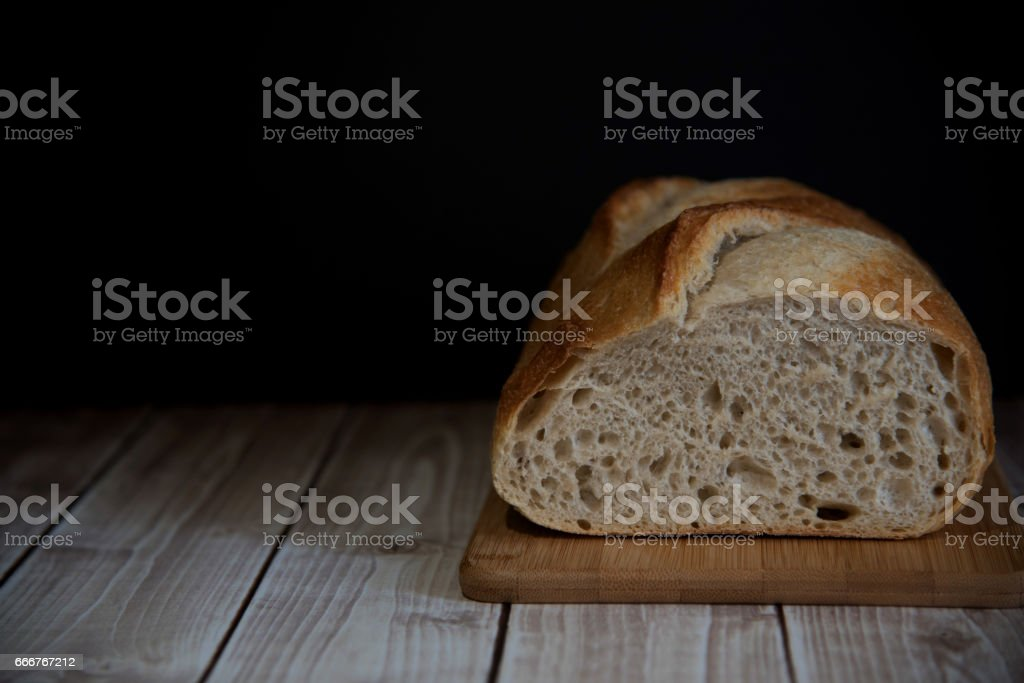 Sourdough homemade bread on the wooden board, dark photo, copy space. foto stock royalty-free