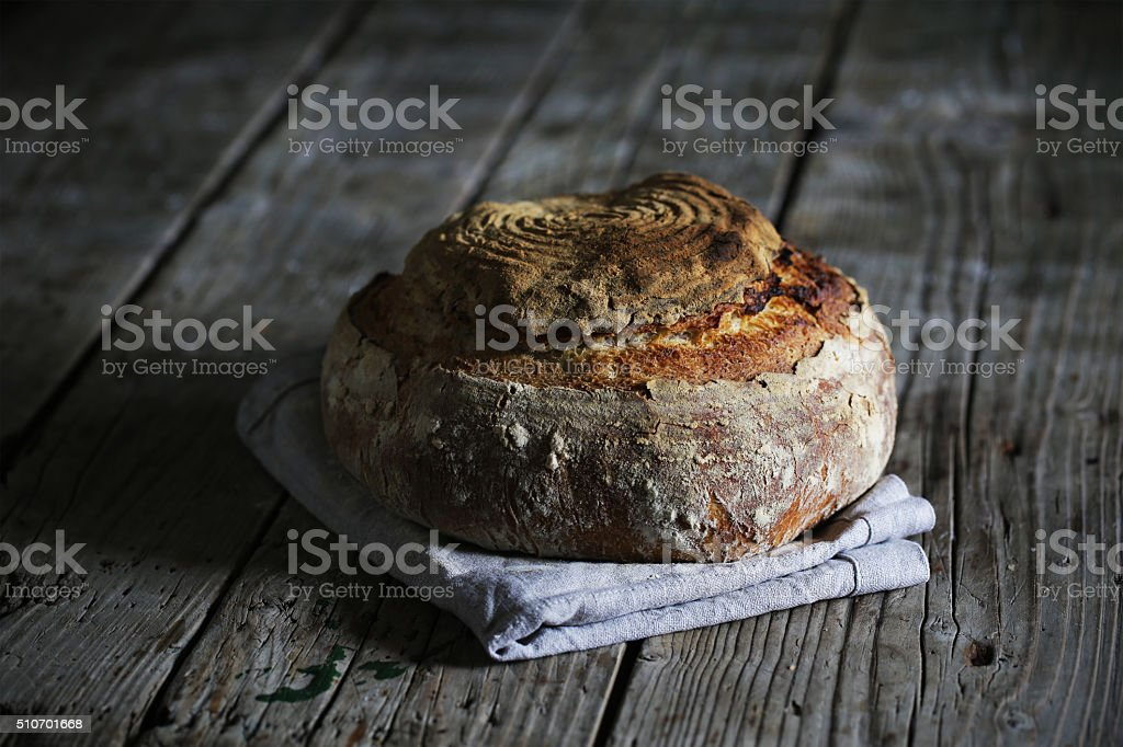 Sourdough rustic loaf, artisanal handicraft bread stock photo