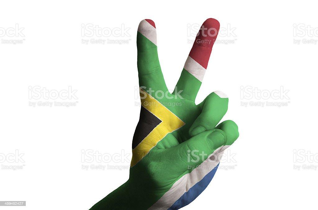 Bandeira nacional da África do Sul com dois dedos para cima gesto de Vitória - foto de acervo